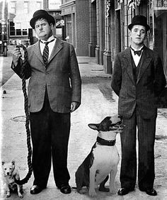 Laurel And Hardy With Their Dogs