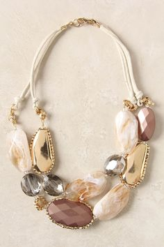 """A dazzling string of faceted baubles romance their way across your neckline.  Lobster clasp, Glass, acrylic, 14k gold plated brass, wax  18.5""""L  1.5"""" bib"""
