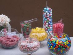 Fill glass bowls with different candies to create a Pic N Mix that guests of any age will love! By Weddings by Image Three