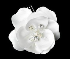 White Silky Matt Satin Flower Bridal Hair Comb  Gorgeous White Silk Matt Satin Bridal Flower Hair Comb has a beautiful shimmering fabric, featuring a cluster of pearl, rhinestone, and Genuine Swarovski Crystal accents. This piece looks absolutely stunning on the side or back of an elegant half-up/half-down hair style and a variety of up do's.Size: Comb Measures 3-1/2 Wide in all Directions ""