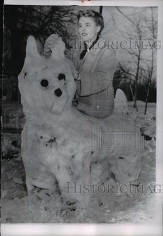 1956 Press Photo Indianapolis Ind Kay David, 16 & snowman in shape of dog