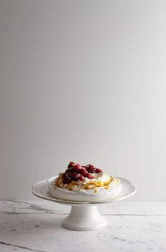 Pavlova | la peche fraiche  translated...French merengue with coconut cream, homemade whipped cream and fruit sauce...all my faves in one dessert!