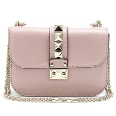 Being ladylike doesn't mean you can't rock. Hence the pyramid studded @Maison Valentino bag. Love. #valentinohandbag