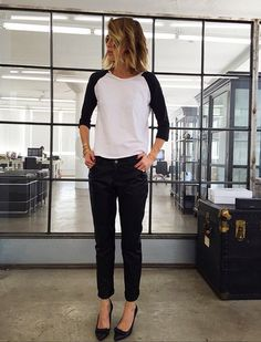 Designer, Anine Bing goes classic in a black and white baseball tee and pumps