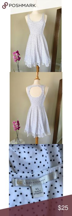 Lauren Conrad polka dot summer dress Lauren Conrad polka dot summer dress size XS,dress has been worn twice, white lace on bottom of dress,back of dress has an open back and has a button to put dress together. Dress does not have zippers. It's very beautiful and perfect for summer☀️ All things from my closet come from a smoke free home  LC Lauren Conrad Dresses Mini