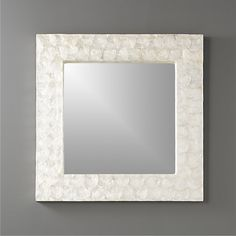 """Shop 24"""" square mother of pearl wall mirror. Classic square mirror framed in iridescent mother of pearl. We love the way it shimmers against the wall. Pretty in pairs."""