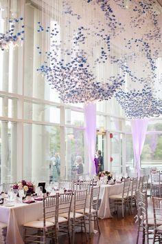 An Elegant Plum Wedding - dramatic string lights,flowers dripping from the ceiling, and illuminated tables topped with purple and fuchsia floral arrangements #wedding #ideas #decor
