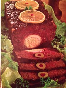 Banana Meat Loaf, with mashed bananas mixed in with ground beef, stuffed with hard-boiled eggs, and festively adorned with orange slices and stuffed olives.  Slice it and observe the reactions of your appalled dinner guests.