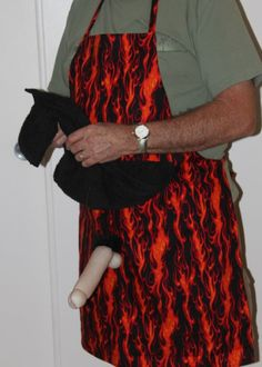 Fire Flames BBQ Apron w/Penis - $30.00 Uh-Oh - Looks like Uncle Pervy wants to BBQ the turkey this year instead of deep frying it... (Apologies to those offended by poorly executed novelty peen.)