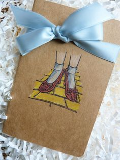 Wizard Of Oz Watercolor Moleskine Journal/Notebook With Dorothy's Ruby Red Slippers. $12.50, via Etsy.