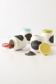 Anthropologie DIY inspiration: baby food jars + spray paint + chalkboard labels {love the fun colored lids}. Good as spice jars. Kitchen Chalkboard, Chalkboard Labels, Chalkboard Paint, Chalkboard Ideas, Chalk Labels, Chalk Paint, Chalkboard Stickers, Jar Labels, Baby Jars