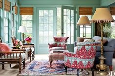 In the sunroom of a Long Island home renovated by designer Daniel Sachs and architect Kevin Lindores, a pair of barrel-back armchairs clad in a Brigitte Singh fabric flank a custom-made ottoman. Green Painted Rooms, Blue Green Rooms, Architectural Digest, Room Inspiration, Interior Inspiration, Design Inspiration, Design Ideas, Long Island House, Interior Decorating