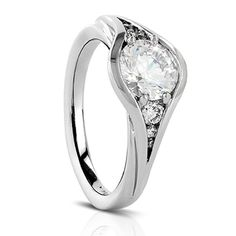 14k white gold ring mounting with graduated size side diamonds totaling 0.14 carats. Price does not include center stone.