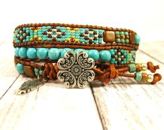 Kim Graham is excited to share the latest addition to her #etsy shop: Turquoise Triple Wrap Beaded Southwest Style Bracelet with Antique Silver Flower Button and Feather Charm https://etsy.me/2JoEAI9