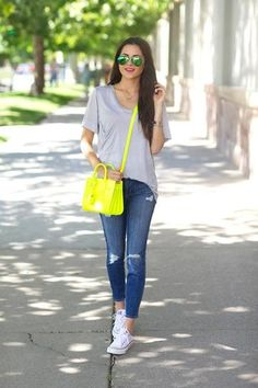 I like this casual look...ripped boyfriend capris, plain grey top and a BRIGHT statement purse.
