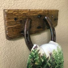Towel holder that I made from a horseshoe and pallet wood.: