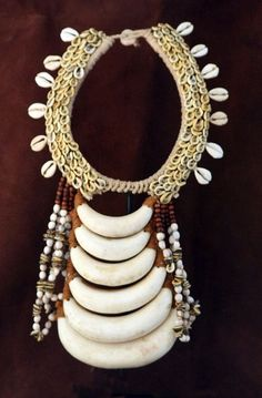 Papua New Guinea | Vintage necklace; shells, board tusks, seeds and natural fiber |