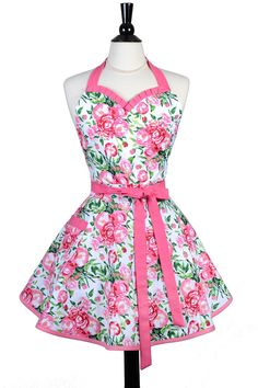 A flirty, sweetheart kitchen apron in retro styling of bright pink spring floral. Full skirt and ruffled neckline gives it a sexy, feminine look. An ideal gift apron for new brides or girlfriends or just wear as a hostess apron for your next dinner party. Details: - 100% Premium