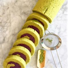 Spongy & moist matcha green tea swiss roll filled with purple sweet potato filling