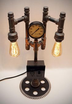 Steampunk Industrial Iron Pipe Lamp with AC & USB outlets, Vintage Pressure Gauge, Boston Sprocket Base, Dimmer, Two LED Bulbs - 24 Steampunk Industrial Iron Pipe Lamp with AC & USB outlets Lampe Industrial, Industrial Home Design, Industrial Light Fixtures, Industrial Lighting, Vintage Industrial, Modern House Design, Modern Interior Design, Lampe Steampunk, Steampunk Makeup