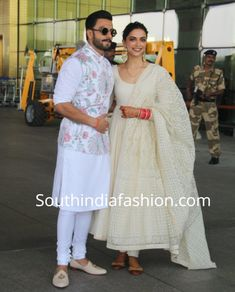 Deepika and Ranveer in Sabyasachi! Newly weds Deepika Padukone and Ranveer Singh were clicked by the shutterbugs at the Mumbai airport today morning as they left to Bengaluru for their wedding reception. The couple were dressed in Sabyasachi outfits. Wedding Dresses Men Indian, Indian Wedding Wear, Indian Gowns Dresses, Event Dresses, Pakistani Dresses, Indian Wear, Mehendi Outfits, Indian Outfits, Indian Clothes