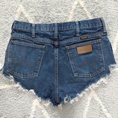 Wrangler Denim Cut Offs from Urban Outfitters Vintage Wrangler Cut Offs from Urban Outfitters.  Marked size 32, would best fit a 28 or 29.  Last image is for fit - the wash is darker is pictured.  High waisted.  Washed but never worn. Urban Outfitters Shorts Jean Shorts