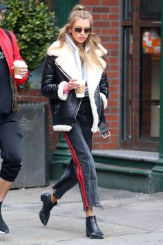 Track pants, ankle boots and oversized shearling jacket