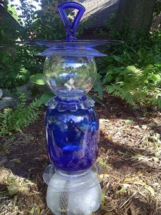 The Vintage Glass Garden is a Milwaukee-based company that offers beautiful handcrafted vintage and depression glassware pieces of art -- from flowers and solar lights to bird baths and bird feeders.