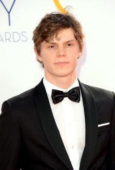 Evan Peters, looking gorgeous in a tux, at the 64th Primetime Emmy's. Follow rickysturn/evan-peters