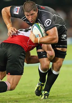 The Sharks'  Willem Alberts powers through a tackle