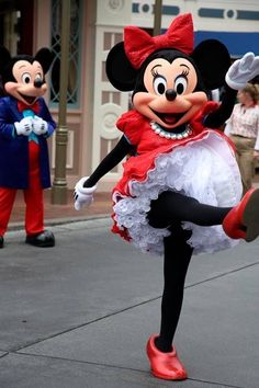 Minnie having fun while Mickey looks on hopefully waiting for a guest or two to meet him.