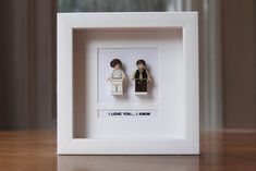 Framed Lego Mini Figures Hans Solo and Princess Leia | This is awesome! Who to make it for is another question.
