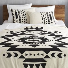 desert daze.  Aztec-inspired black  ikat pattern makes big, bold impression atop off-white cotton/linen blend landscape.  Duvet cover has nonslip corner ties and hidden button closure; shams are finished neat with envelope closures.  Each reverses to solid off-white.