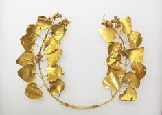 Greek Gold Ivy Funerary Wreath With Berries, 4th-3rd Century BCE. In ancient Greece, ivy wreaths were usually associated with the worship of Dionysus and were sometimes used at festivals in honor of the god. They were also left in the graves of wealthy individuals.