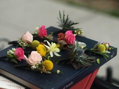 Bright and colorful boutonnières. Featuring thistle, spray rose, crispedia, brunia and yarrow. Wrapped with black ribbon. #colorful bouts #blue #colorful groomsmen bout #unique flowers #book and burlap #rosehip social www.rosehipsocial.com