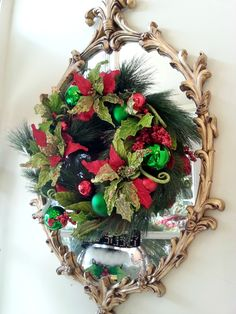 Love this look,  hanging a wreath over a mirror.