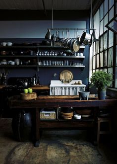 dark kitchen, wall of windows