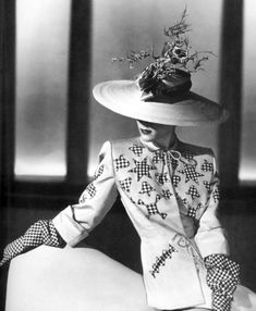 A day suit and hat by Adrian, the MGM costume designer who left the studio in 1941 to start his own fashion house.