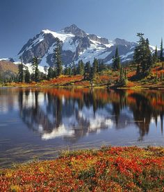 #Fall hiking is definitely worth it on Americas #publiclands. At 9127 feet #MountShuksan towers over the alpine meadows and deep valleys of #NorthCascades National Park in #Washington. This photo of the snow-capped Mt. Shuksan (located in @ncascadesnps) was taken from nearby Picture Lake at Heather Meadows within Mt. Baker-Snoqualmie National Forest. Photo courtesy of Ed Cooper (@ed_cooper_photography). by usinterior