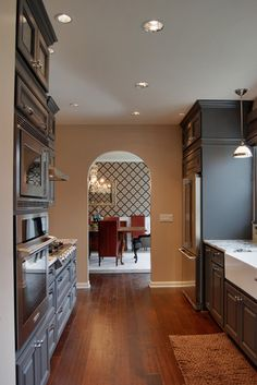 pic 5 of 5. http://www.jasonballinteriors.comLooking back from the kitchen to the dining room, the interplay between pattern and color is obvious