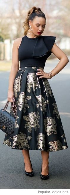 Black top and skirt with some nice details