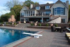 Brick patio around pool, seat walls, steps