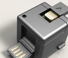 WonderCube - is an all in one smartphone accessory that can  be used to charge your handset by connecting it to a USB port, sync files, read memory cards,or charge a 9V battery. You can also use it as a phone stand. And remember all these functions are accomplished by a 1 cubic inch device that can easily be worn as a key-chain.