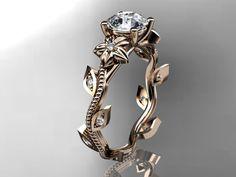 14kt rose gold diamond leaf and vine ring.