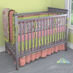 Crib bedding in Coral Mini Stripe, Solid Light Lime, Watercolor Paisley, Solid Light Coral. Created using the Nursery Designer® by Carousel Designs where you mix and match from hundreds of fabrics to create your own unique baby bedding. #carouseldesigns