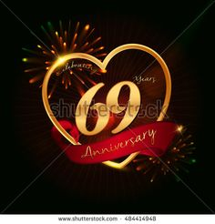 69 years anniversary logo golden colored,with love shape, red ribbon, and fireworks background
