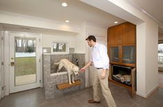I love this laundry room make-over with special spaces for the dogs. Entry by Four Brothers LLC