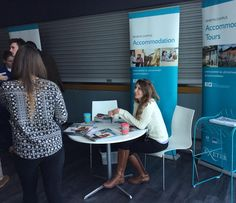 Steph from the Accommodation Team chatting to prospective students at The University of Exeter open day