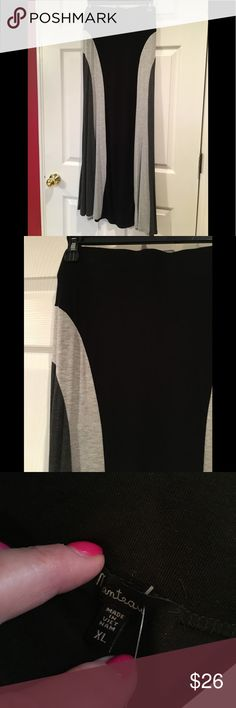 Maxi all the way! To the Max--i for curves. Figure flattering even if you don't have curves this maxi will give you subtle. In black and gray. Add a great boot and maybe my Moda international cardigan. Monteau Skirts Maxi