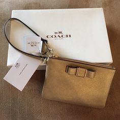 Coach Gold Wristlet Adorable gold Wristlet. New in box never used. Less on Ⓜ️ercari, make offer. Coach Bags Clutches & Wristlets